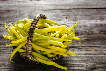 Freshly harvested vegetables. Yellow beans fresh from the garden, organic food concept Stock Photo