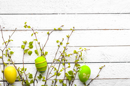 Easter background with colored eggs on white wooden table Archivio Fotografico - 113846703