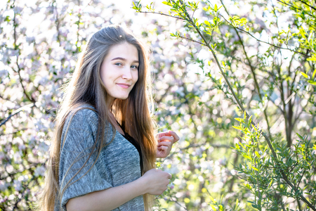 Beutiful glamour girl portait outdoor in nature at spring. Woman with natural beauty face skin.