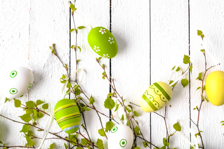Happy easter egg with pattern. Colored eggs on white wooden background. 写真素材