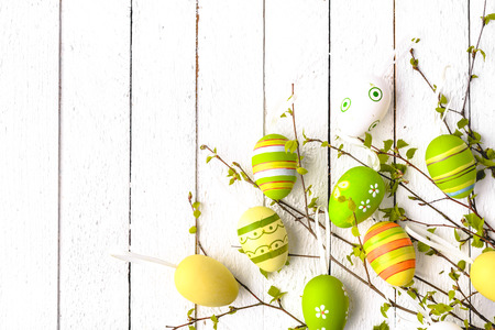Easter background with eggs and easter branch on white wooden board 写真素材