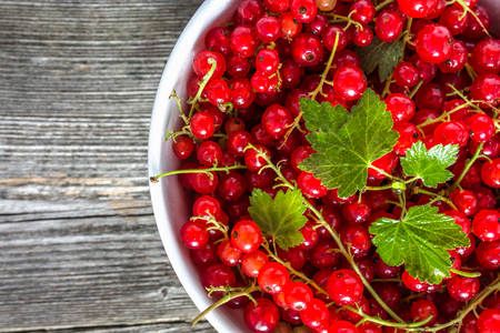 Fresh red currant, closeup in a bowl, top view