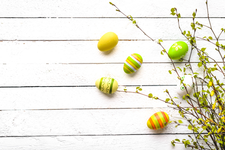Spring branch and easter eggs on white background. Painted egg on branches. 写真素材