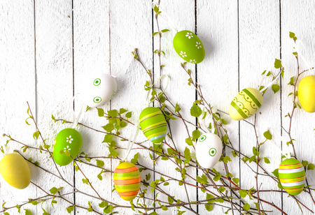 Fresh green branches with easter eggs, spring easter background 写真素材