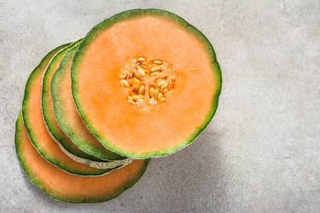 Half of melons, orange cantaloupe melon slices