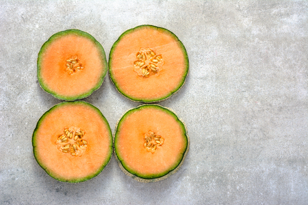 Half of melons, orange cantaloupe melon slices