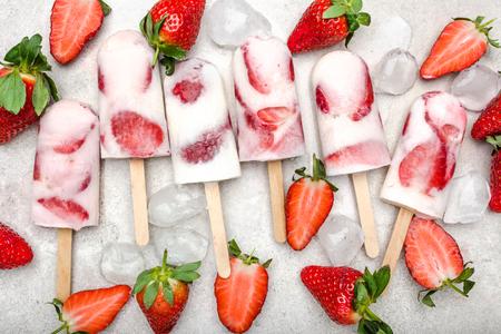 Homemade popsicle or strawberry ice cream with yogurt