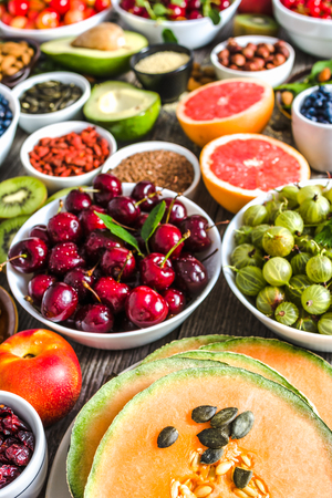 Fresh fruits and other healthy food. Organic breakfast containing superfoods, vegetarian nutrition like nourishing fruit, nuts and seeds.