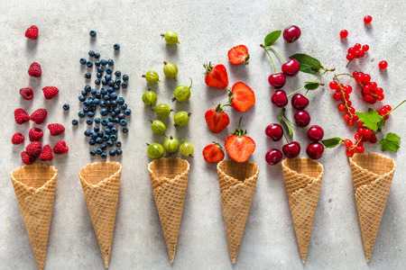 Ice cream cones with fruit, flat lay, top view