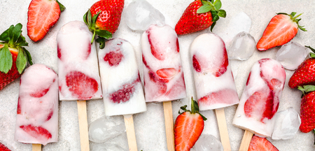 Fresh strawberry popsicles. Juicy ice cream with fruit, food for refreshing in the summer. Stock Photo - 120320633