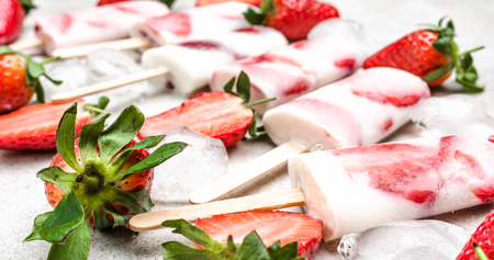 Fresh fruit ice lolly. Strawberry ice cream frozen with berry and yogurt.