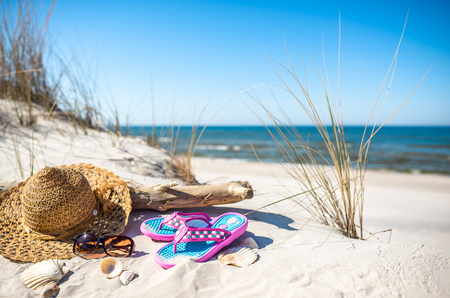Summer vacation landscape with beach accessories, sand and sea view, Baltic, Poland