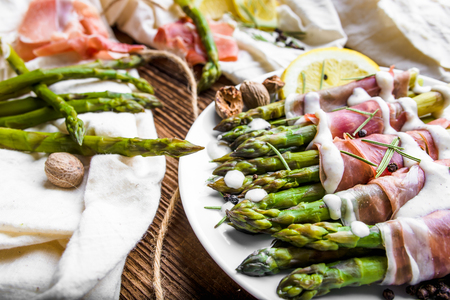 Italian dish with cooked asparagus wrapped with prosciutto ham Stock fotó