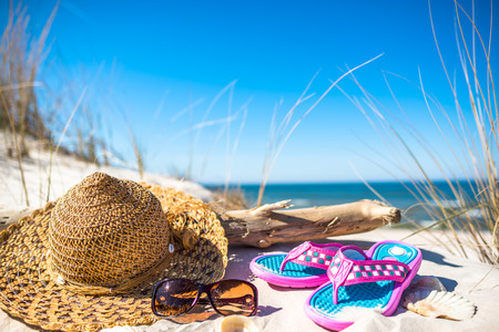 Holiday accessories on the beach, summer vacation and over sea recreation concept