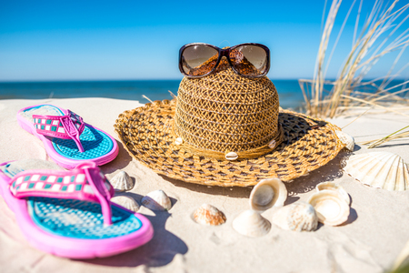 Beach accessories, summer vacation background, Baltic Sea with blue sky, Poland Stock Photo