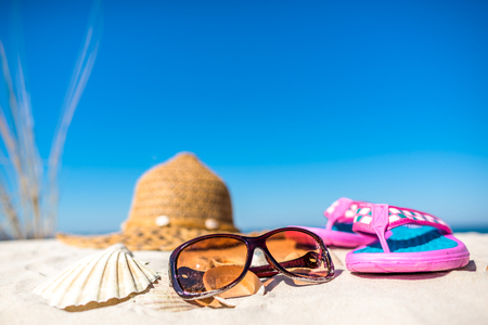 Summer beach accessories on sand, tourism, vacation and seaside recreation concept