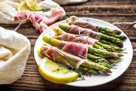 Italian food - cooked asparagus with meat - appetizer on plate
