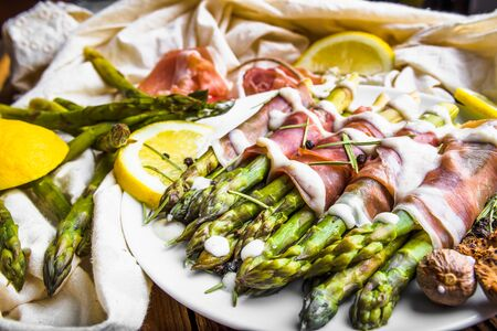 Delicious cooked asparagus with sauce, italian food concept