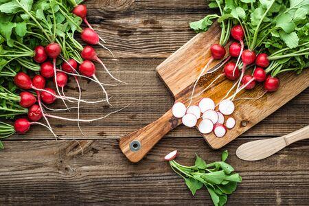 Garden radish, slices of fresh red radish on cutting board