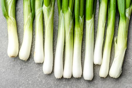 Farm fresh vegetables. Organic, freshly harvested onion. Spring green onions, background.