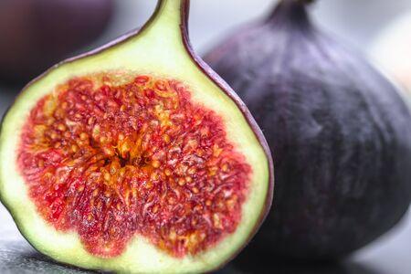 Fresh figs fruit. Slice of fig, closeup. Stock Photo