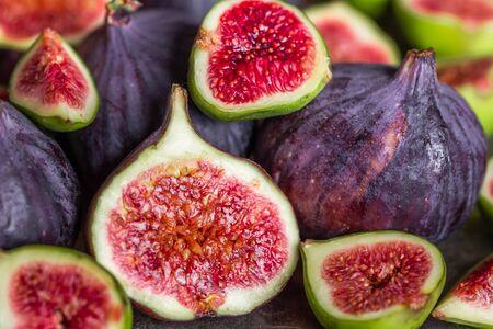 Fresh juicy figs fruit. Fig slice, closeup. Stock Photo