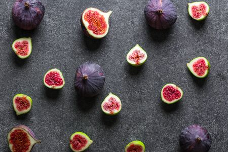 Fresh figs fruit. Purple fig slices, flat lay, top view.