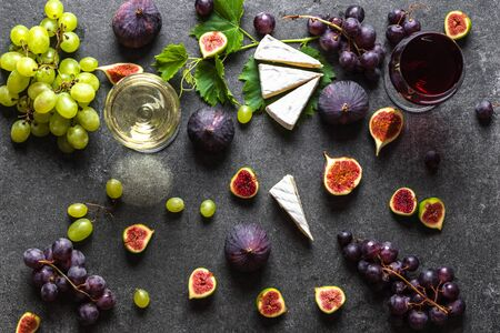 Food background. Fruit, wine and cheese. Wine snack set. 写真素材