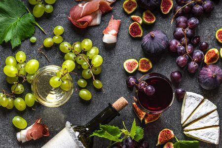 French food or ilalian snack wine. Red and white wine, cheese, figs and grapes.