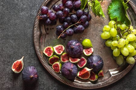 Bio organic fruits. Fresh figs and grapes. Assorted fruit on catering platter. Food for sharing. 写真素材