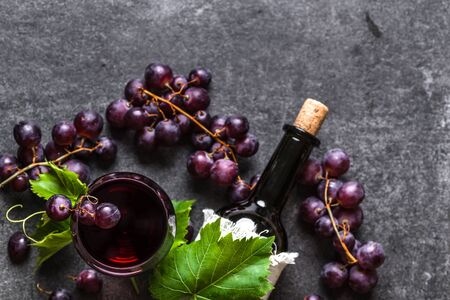Grape wine background. Red wine glass and bottle with cork. 写真素材