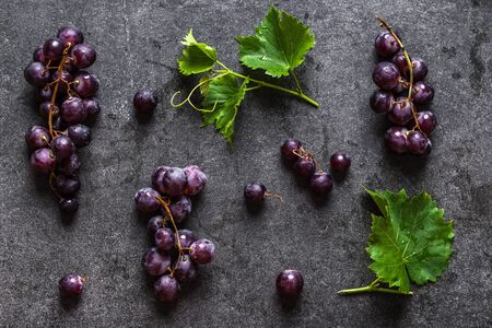 Fresh red grapes on dark background