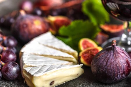 French cheese - camembert, grapes and figs
