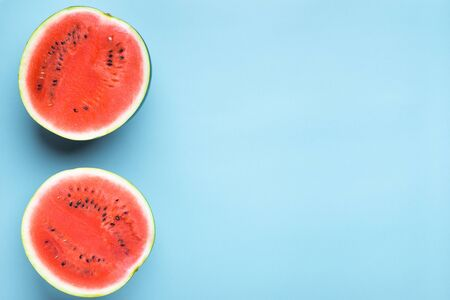 Colorful fruit background of fresh watermelon halves