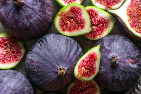 Fresh fig fruit and slices of figs, background Stok Fotoğraf