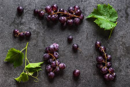 Fresh purple grapes, flat lay from above