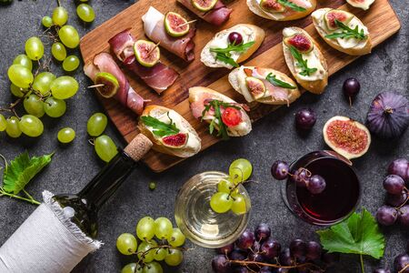 Buffet with wine snack set. Traditional tapas - spanish table with food or italian appetizer: bruschetta with cheese and meat.