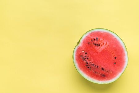 Fresh slice of watermelon, top view on yellow background