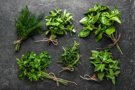Garden herbs, freshly harvested bunch of herb, flat lay, top view