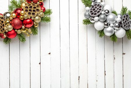 Christmas wreath on wood background with glitter ornaments and christmas tree