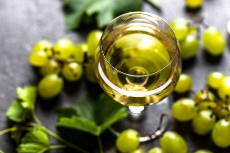 Fresh grape and white wine glass