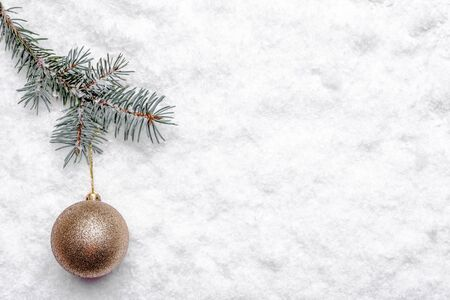 Christmas snow, fir tree branch and ornament, christmas background Banco de Imagens - 133903429