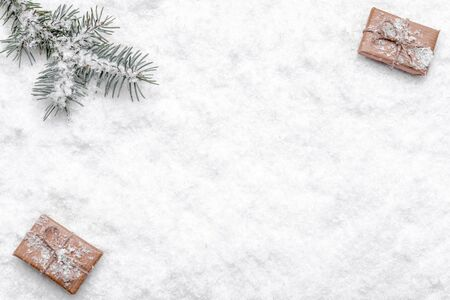 Christmas snow background with christmas gifts and pine tree branch, top view, flat lay Stock fotó