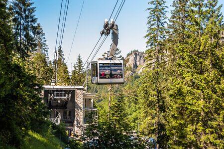 TATRA, POLAND - 3 July 2015: Polish Tatra Mountains, near Zakopane, view on a cable car PKL - Polskie Koleje Linowe on Kuznice station background in the direction of Kasprowy from trail to Giewont Publikacyjne
