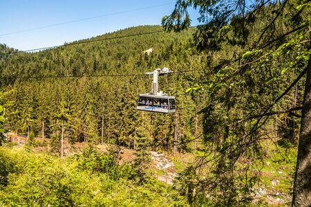 TATRA, POLAND - 3 July 2015: Polish Tatra Mountains, near Zakopane, view on a cable car PKL - Polskie Koleje Linowe to Kasprowy Wierch from Kuznice. Photo from trail to the top of mount Giewont. Publikacyjne