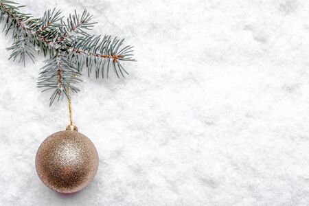 Christmas background with snow, fir branch and bauble, christmas banner, copy space