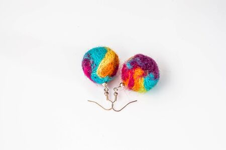 Felt earrings beads shaped. Handmade stylish felt jewelry made with colorful felt beads isolated on a white background.