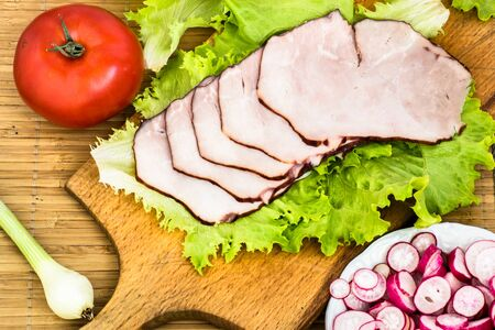 Healthy breakfast with meat, sliced ham and vegetables on kitchen table Reklamní fotografie