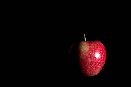 Delicious fresh red apple on black background Banco de Imagens