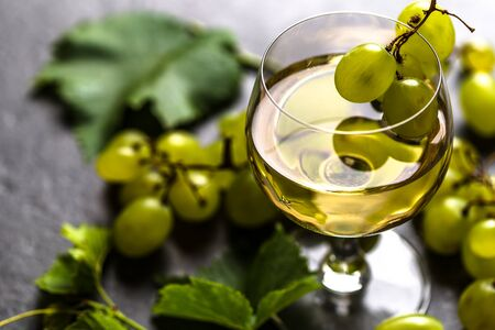 Fresh fruit and wine. Glass of white wine with grapes.